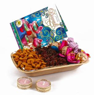 Diwali Hamper of Pan, Almonds, Chocolates, diya and  Card