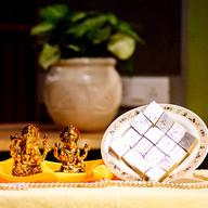 Laxmi Ganesha Idol with Kaju Katli