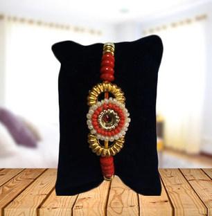 Round Pearl and Golden Rakhi