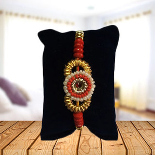 Round Pearl and Golden Rakhi