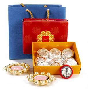Kaju Pista Sweets with Coin and Diyas