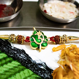 Exquisite OM Rakhi