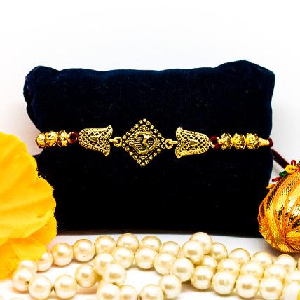 Exquisite OM Golden Rakhi