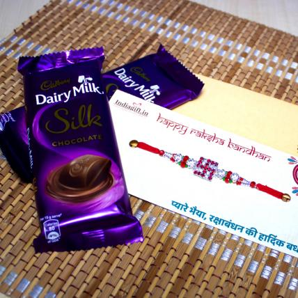 Shining Swastika Rakhi with Dairy Milk Silk Chocolates