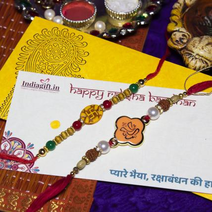 Kesari Ganesha & Swastika Rakhi Set