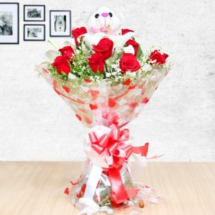 Elegant roses and lilies including teddy