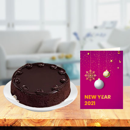 New Year Chocolate Cake with New Year Greeting Card
