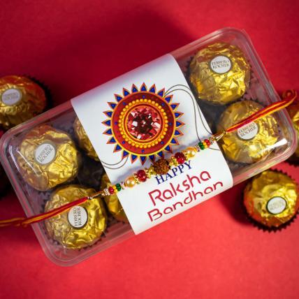 Colour Rudraksha Rakhi and 16 pc Forrero Rocher